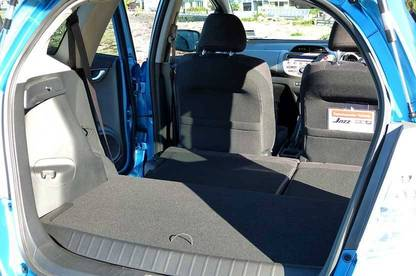 The Honda Jazz Hybrid's rear seats fold down with a simple flick of a lever.