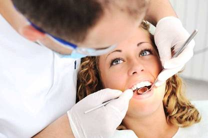 Your dentist will check your teeth and any cavities or cracks will be repaired.
